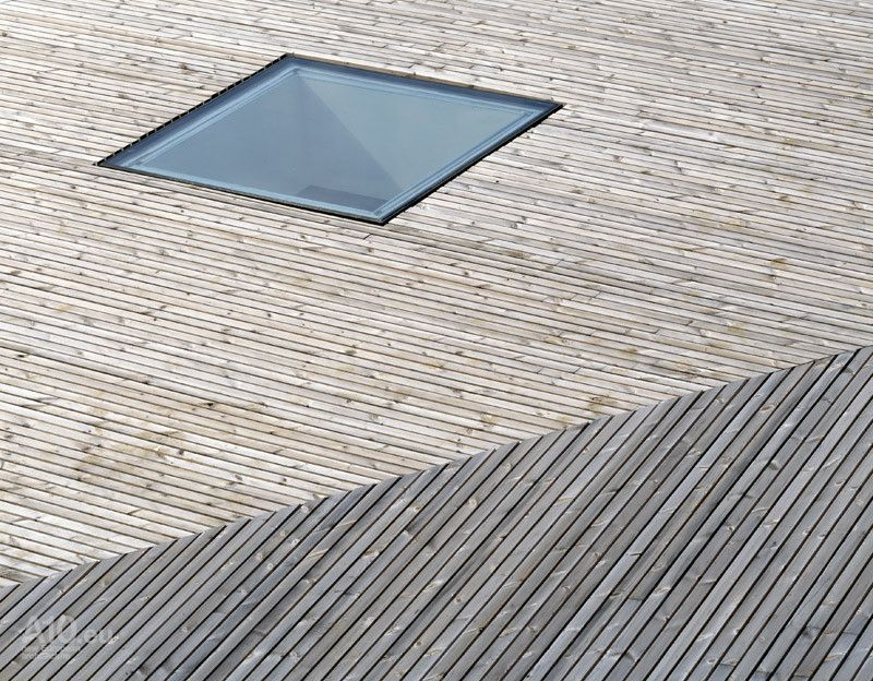 The Cladding On The Undulating Roof And Walls Is A Rainscreen System Using  Shaped Thermowood Boards