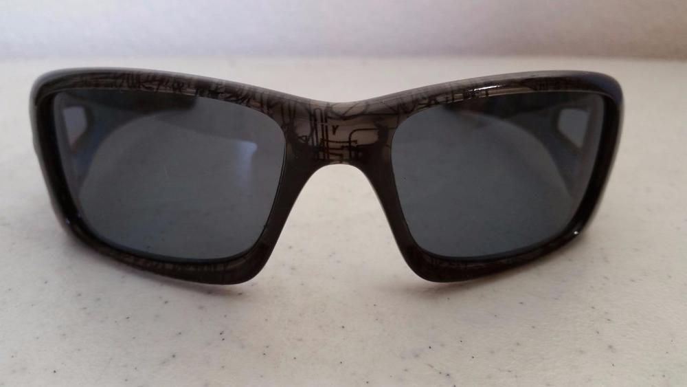 192edf6649a  49.95 Oakley Crankcase Sunglasses 9165-06 Clear Gray History Text Frame Polarized  Lens  OakleyCrankcase  Wrap