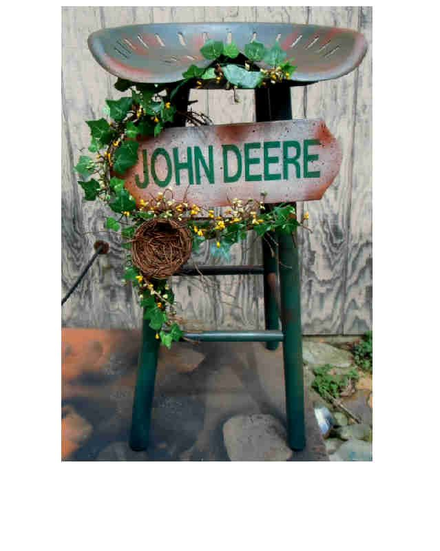 I took a old wooden bar stool I purchased.I then added a old tractor seat.I painted and antiqued it.I added the John deere sign I custom made.It was decorated with vine and pip berries and a crafty little bird nest.