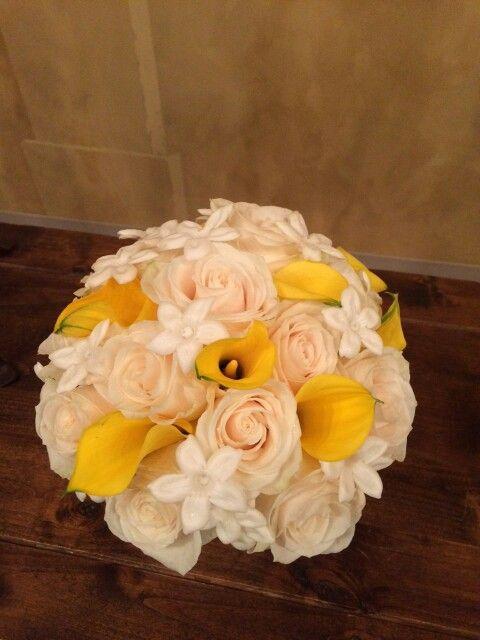 yellow calla lilies, white roses and stephanotis