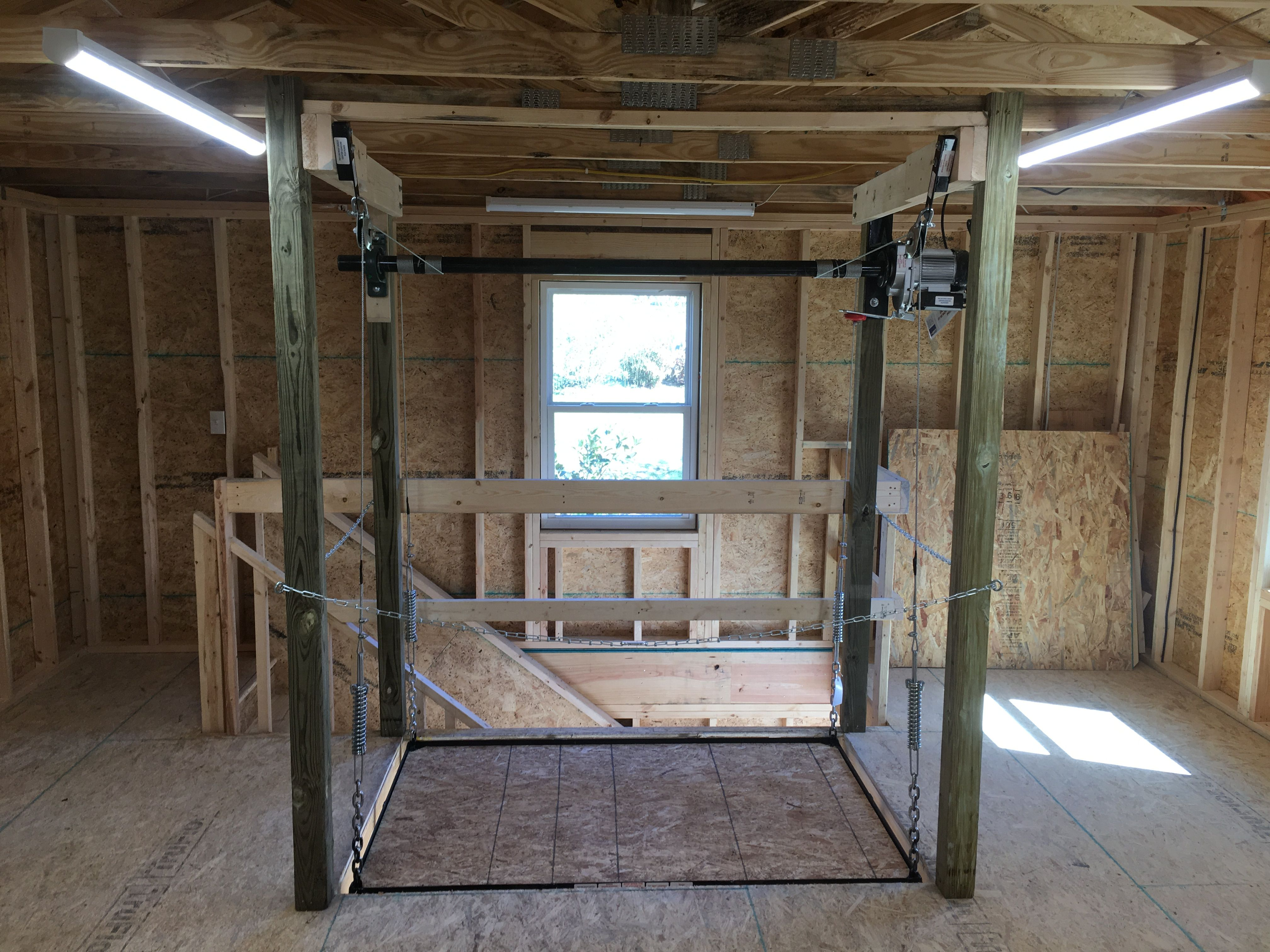 The Attic Lift Is A Garage Lift System That Is Motorized Designed To Safely Move Items Up And Down Without Going Up The Atti Attic Lift Garage Lift Attic Rooms