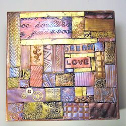 Mosaic Made With Textured And Foiled Polymer Clay Tiles The Is On A Distressed