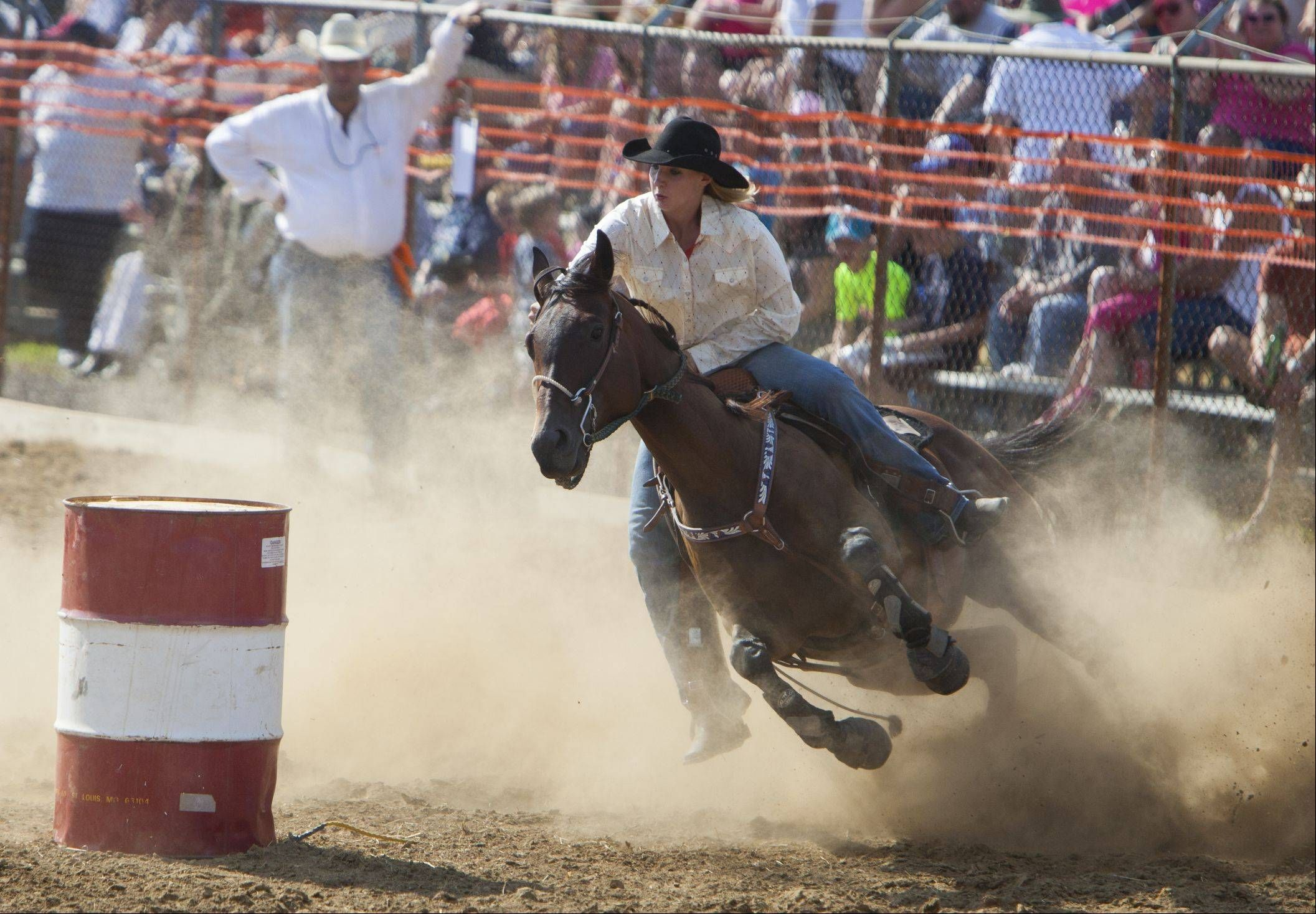 Jamie Gellman of Wauconda rounds a barrel Sunday during the 49th IPRA Championship Rodeo at the Golden Oaks Rodeo Grounds, hosted by Wauconda Chamber of Commerce.