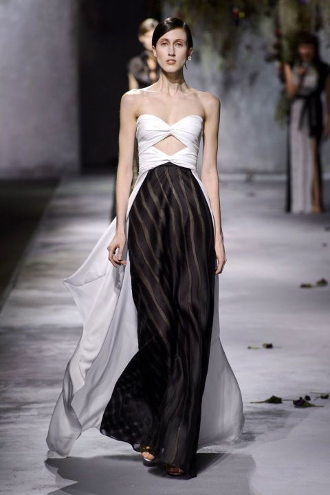 Then Ashkenazi changed directions, going tough with pleated black leather and body harnesses that peeked out from underneath dresses and sporty separates.