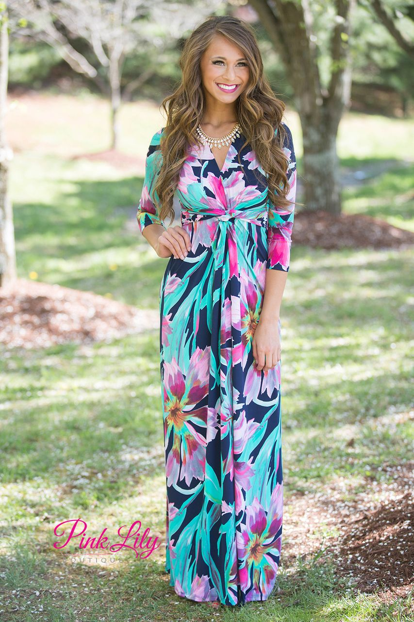 dac894be2c9 Make a statement in this classic 3 4 sleeve dress! Featuring a floral print  with bold shades of mint