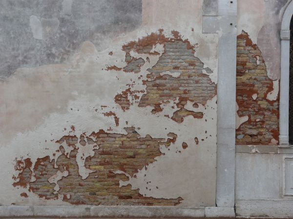 Worn Brick Wall Partly Covered In Thin Layer Of Concrete Painted In Cream Color Painted Brick Walls Brick Interior Wall Textured Walls
