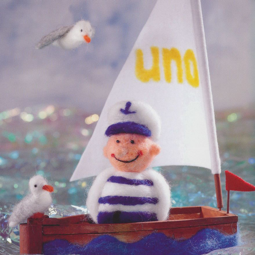 Zeeman, boot en zeemeeuwen