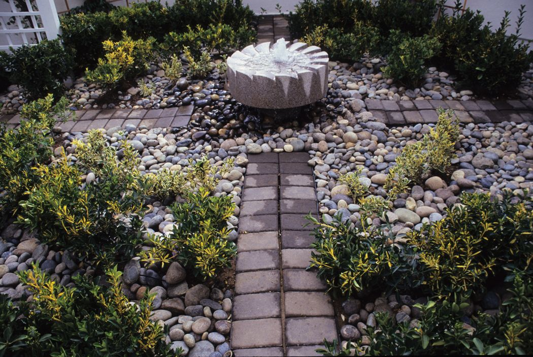 Grinding Stone Water Feature Punctuates A Residential Courtyard In Gilroy,  CA