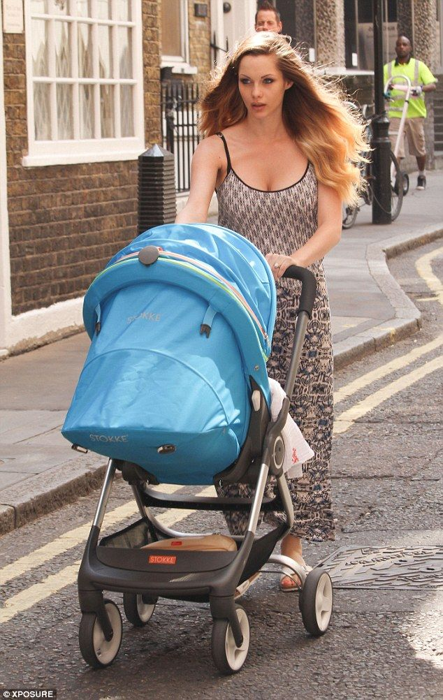 d8a795ff0a64 Jessica-Jane Clement enjoys family stroll with husband Lee Stafford and her  Stokke Scoot stroller