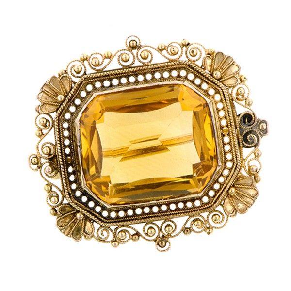 Victorian Citrine Filigree Pin::measuring app. 1 1/8 x 1 inch, centering a rectangular citrine measuring app. 17.0 x 14.0mm, in a filigree frame, fashioned in 10k gold. Circa 1890.