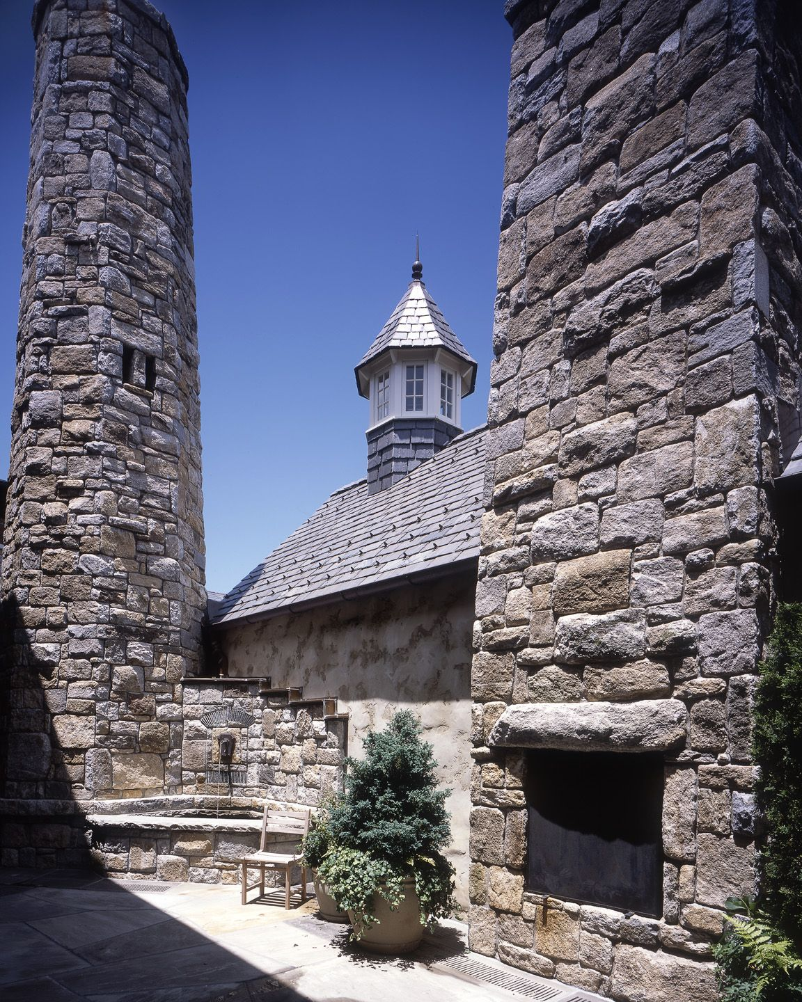 Luxury Suite Exterior with outdoor fireplace in the Spa Courtyard at Old Edwards Inn and Spa