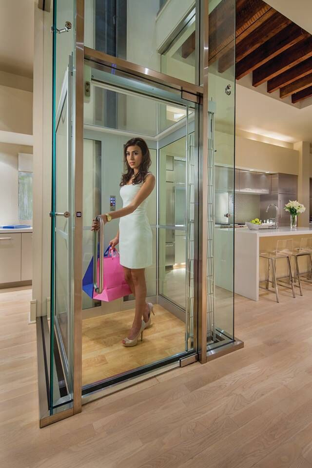 Modern home elevators by inclinator co of america home for Home plans with elevators