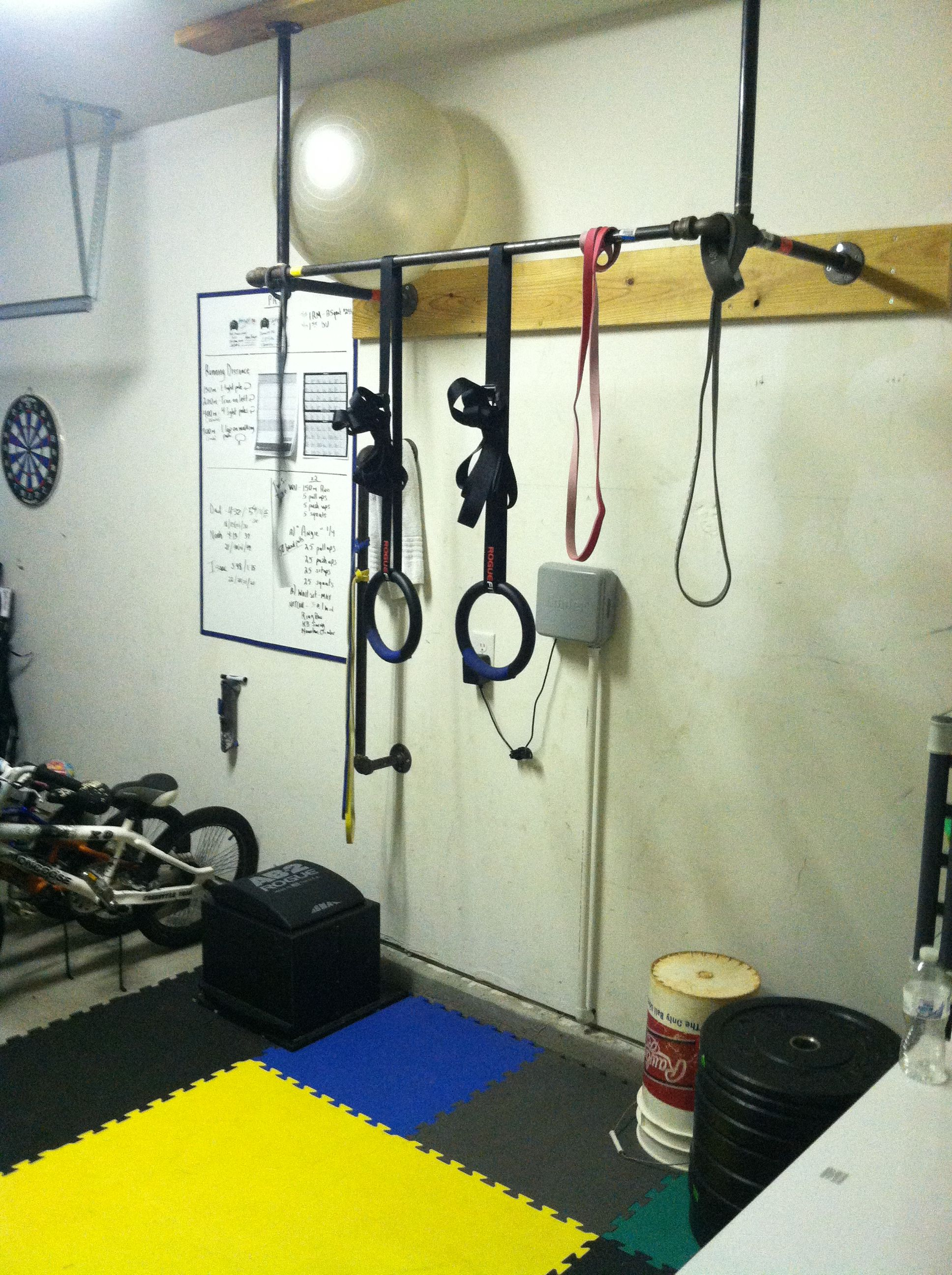 Homemade pullup bar with used sprinkler pipe .before squat rack