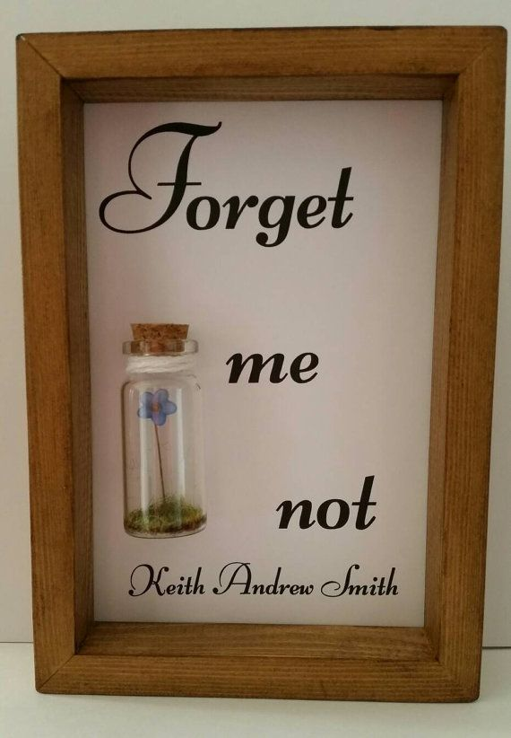 A single forget me not flower enclosed in a small glass bottle. Works perfectly as a leaving gift or as a touching remembrance.