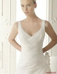 V-neck #wedding gown with side detailing. Sure to keep you comfortable while still looking fabulous!