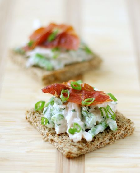 """Open-Face Chicken Salad Sandwiches - That's a bit of ham on the top, but bacon or even an olive will work, too. TIP:  I used half the Mayo they call for in this recipe.  Added a couple teaspoons of sour cream instead, and it came out so... fluffy.  We """"nosh"""" on Sunday nights around here, just eating appetizers, fruit, small sandwiches, etc.  It's almost like a party with just our family... and we look forward to Sunday nights."""