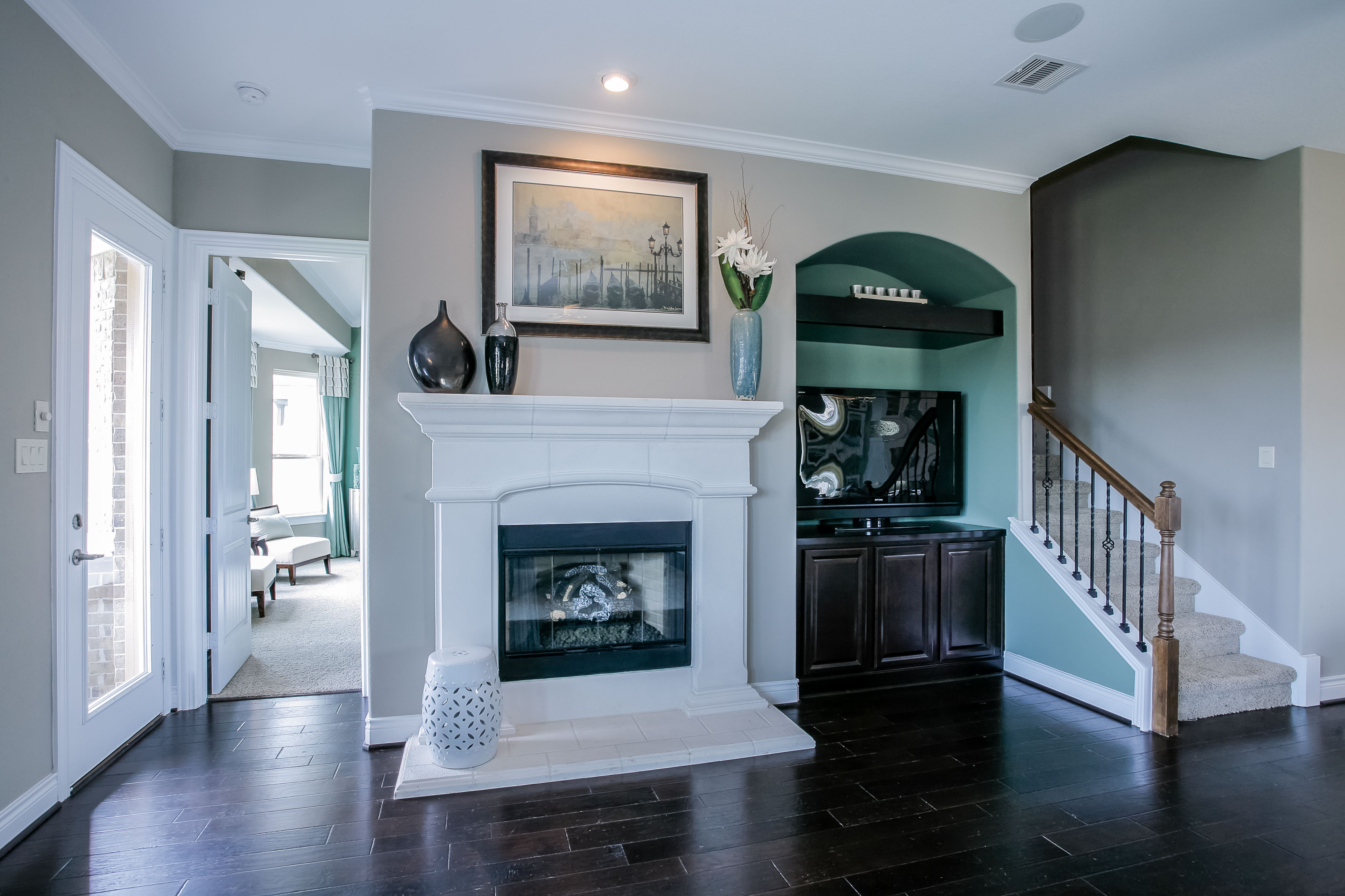 gehan homes redwood fireplace white stone fireplace dark hardwood