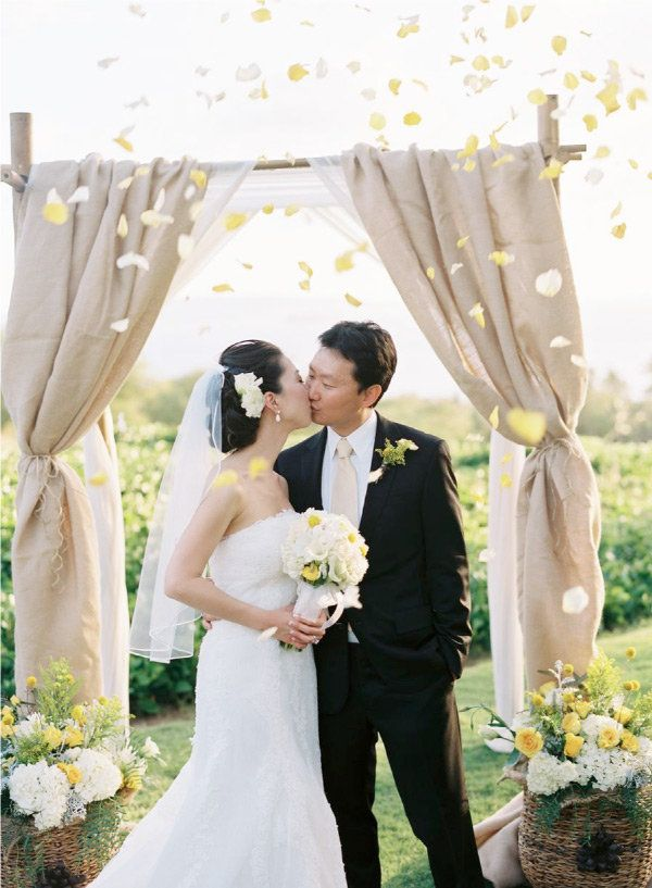 If you're going with simple drapes, ground the look with sturdy flower baskets to create a gorgeous tableau.  Source - www.casasugar.com