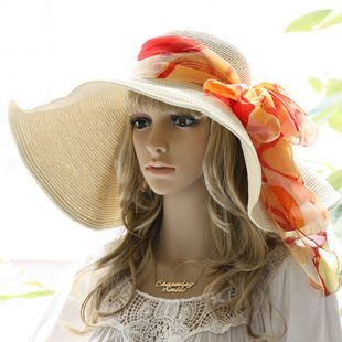 Tie your favorite silk scarf around your hat in a bow for a personal touch a0e40449e3f