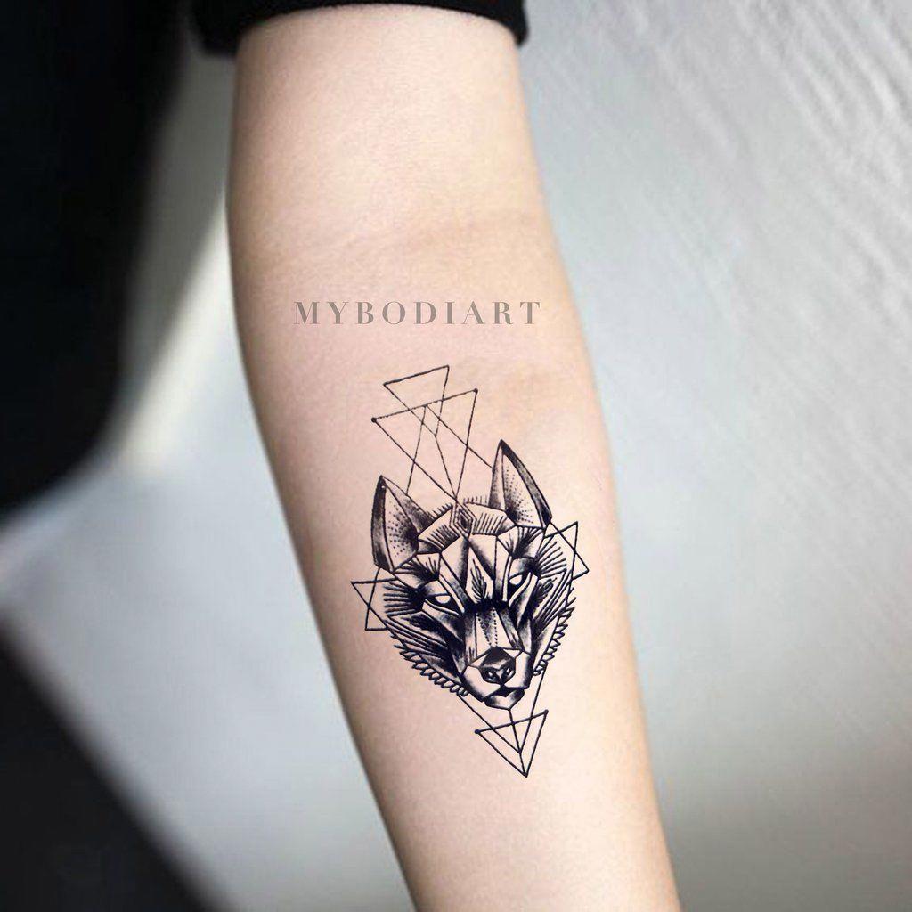 Small Tribal Wolf Forearm Tattoo Ideas For Women Black Geometric Feminine Native American Tradi Geometric Wolf Tattoo Wolf Tattoos For Women Tattoos For Guys