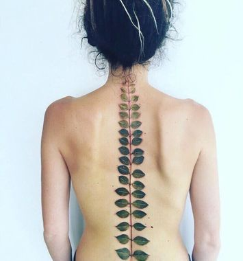Photo of Botanical Spine Nature Tattoo