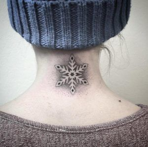 Negative space dotwork snowflake tattoo by Fanny