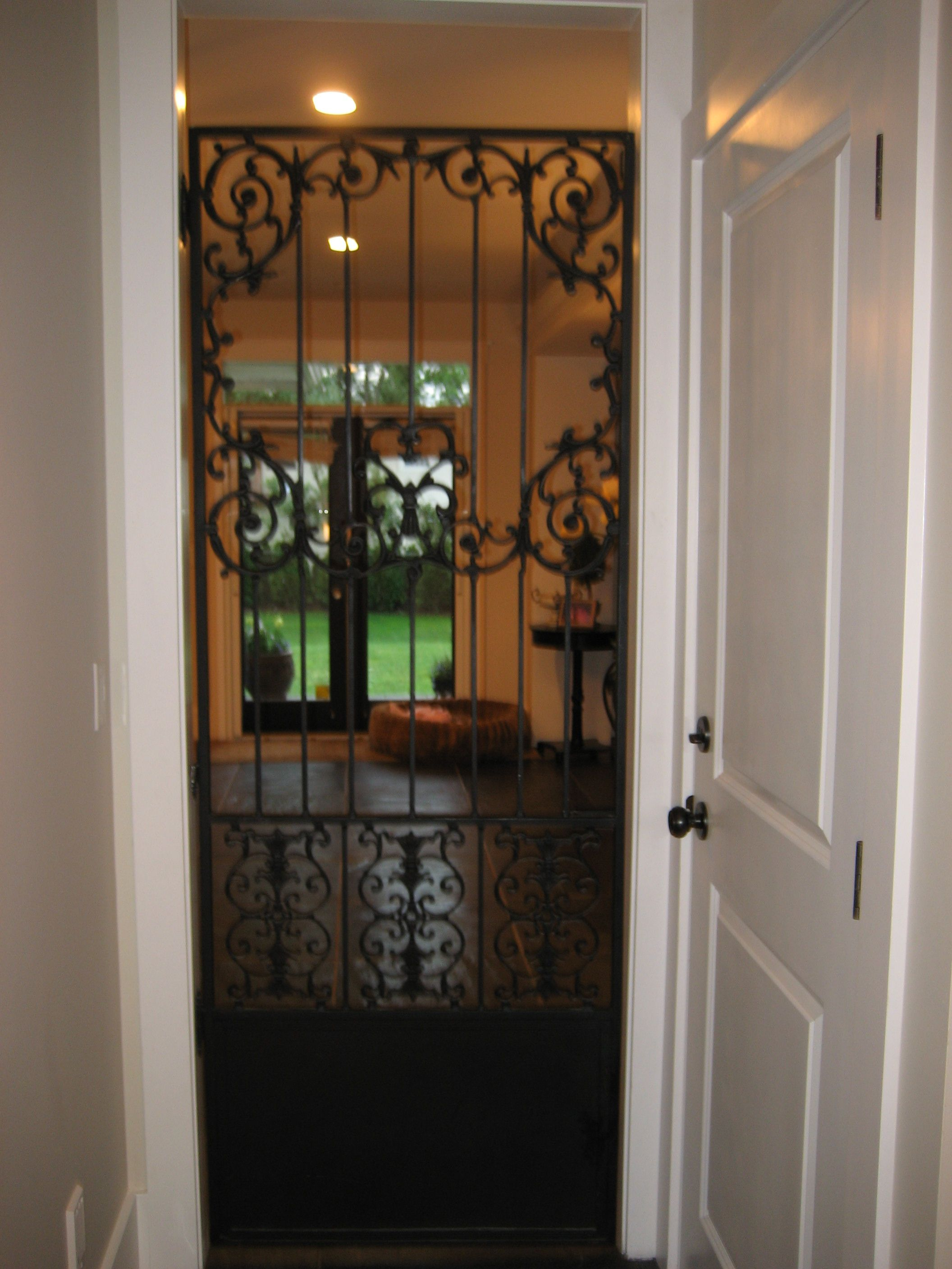 Wrought Iron Door To Separate Mud Room From Hearth Room