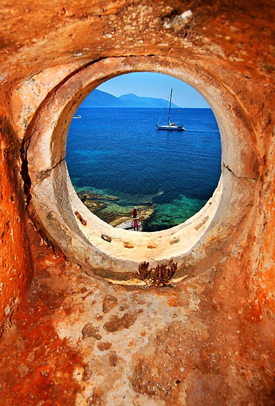 """""""Window to the Ionian Sea"""". Photo taken through the window of the old Venetian lighthouse close to Fiskardo. In the background you can see Ithaca island."""