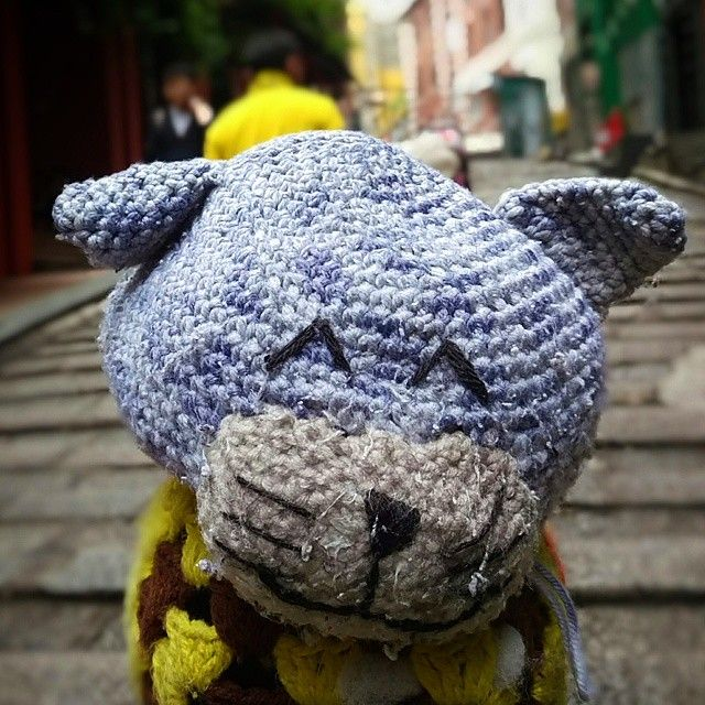 Got to love people in Hong Kong. They made a Crochet toy for the knob on the railing on the steep slope up to Lan Kwai Fong. Cute.