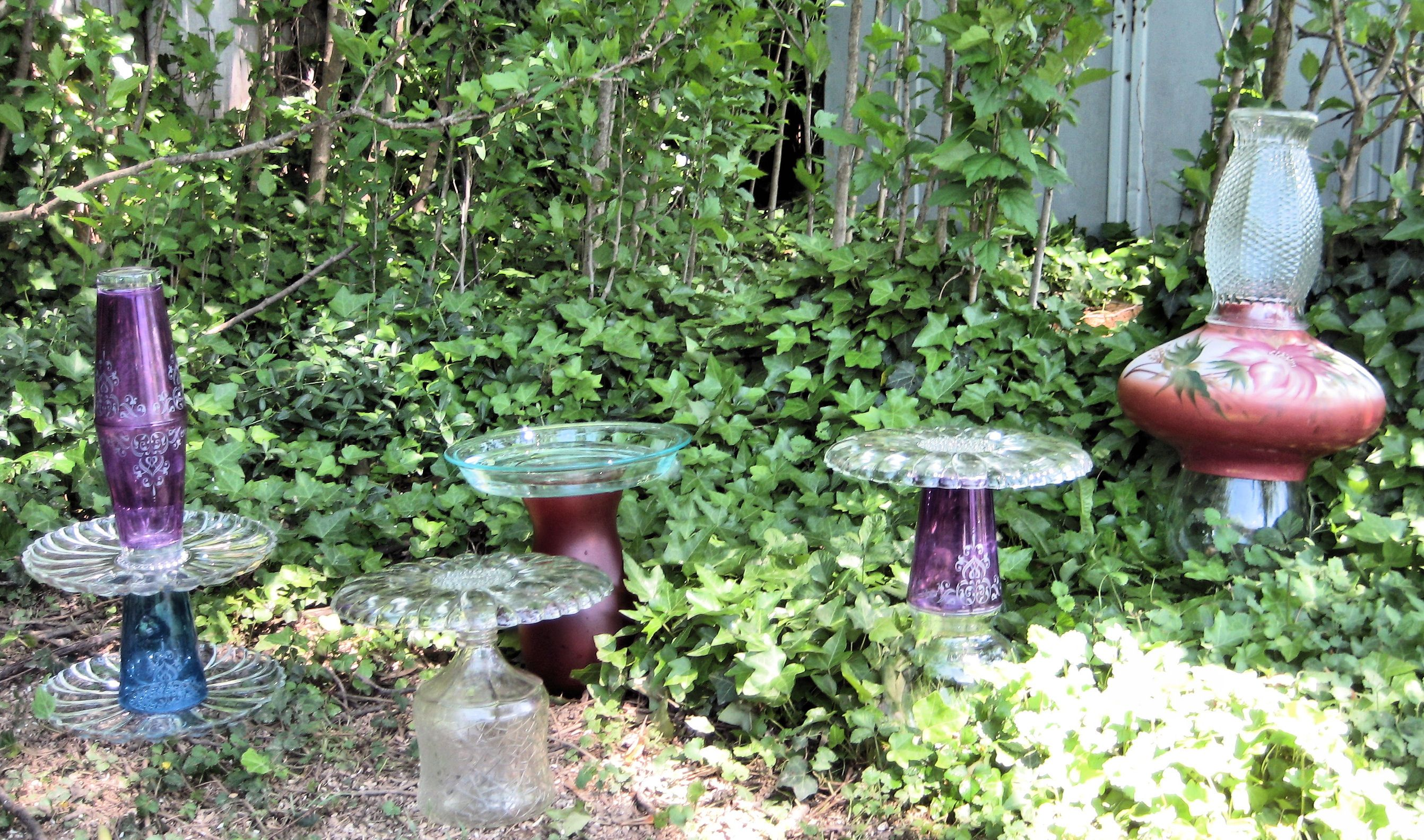 Bird bath, plant stand, glass totems from yard sale vases, glasses ...