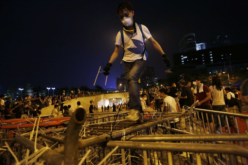 The police pushed protesters out of a park using pepper spray and wrestled some of those who resisted to the ground.