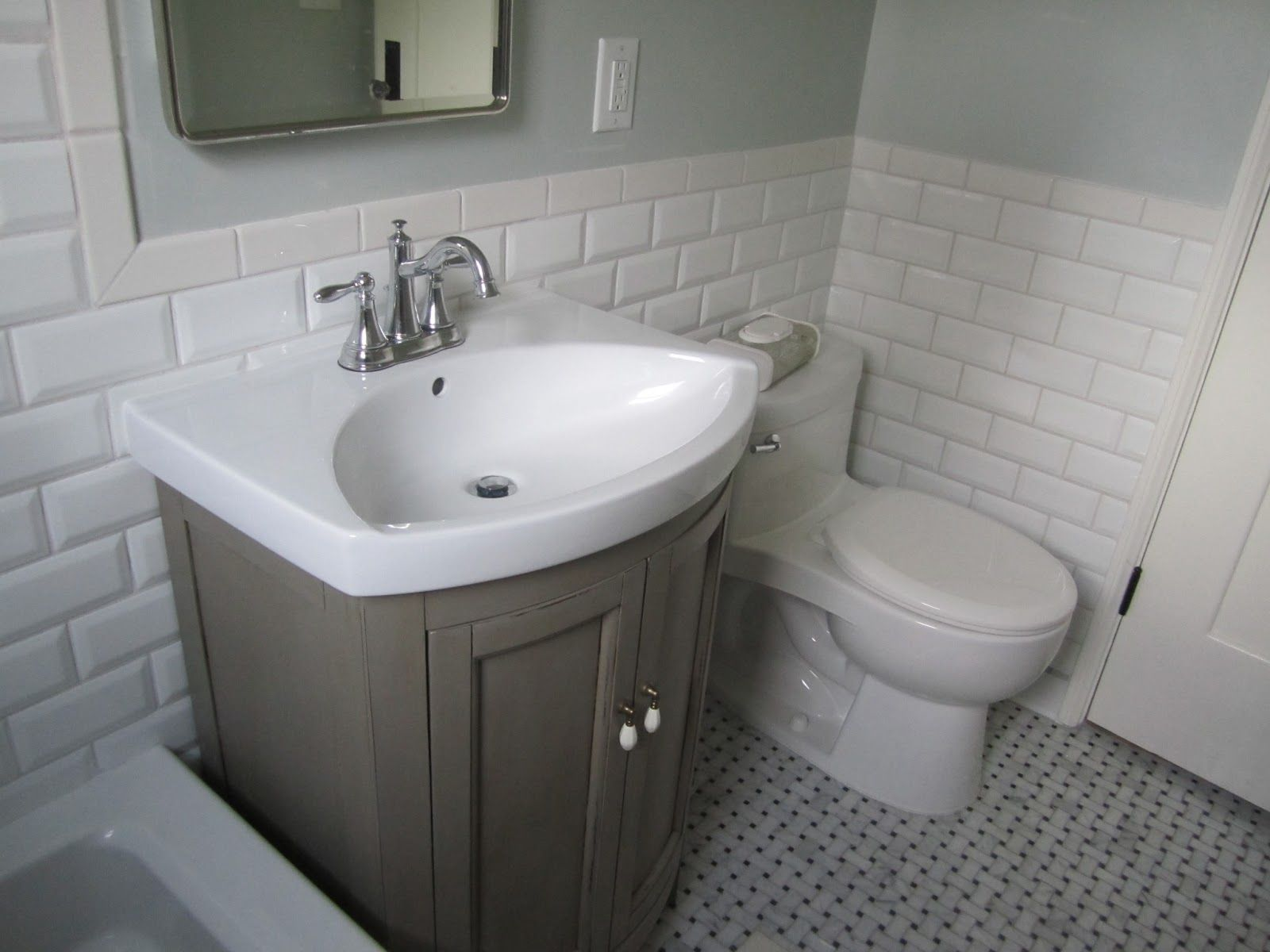 Classy White Subway Ceramic Bath Wall Tiled And Gray Single Sink Small Vanity As Decorate In