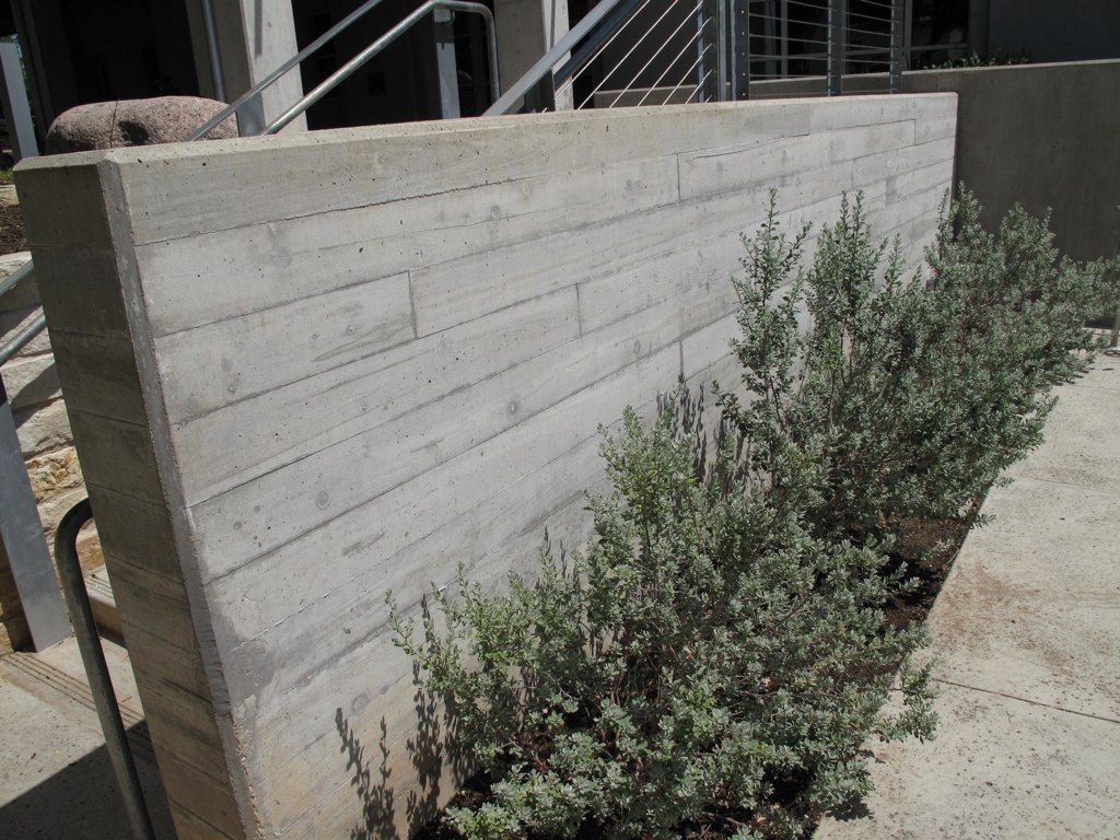 Board Formed Concrete Could Be Used In Front Area Instead Of Stone Board Formed Concrete Concrete Retaining Walls Concrete Patio
