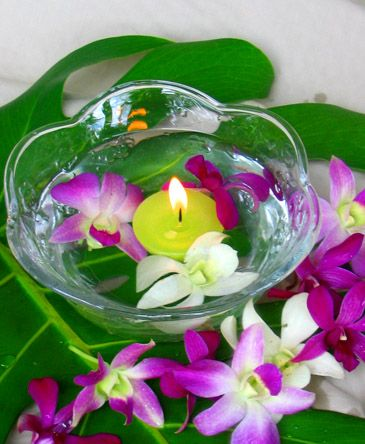 Hawaiian loose orchid blossoms perfect for making leis or for Beta fish centerpiece