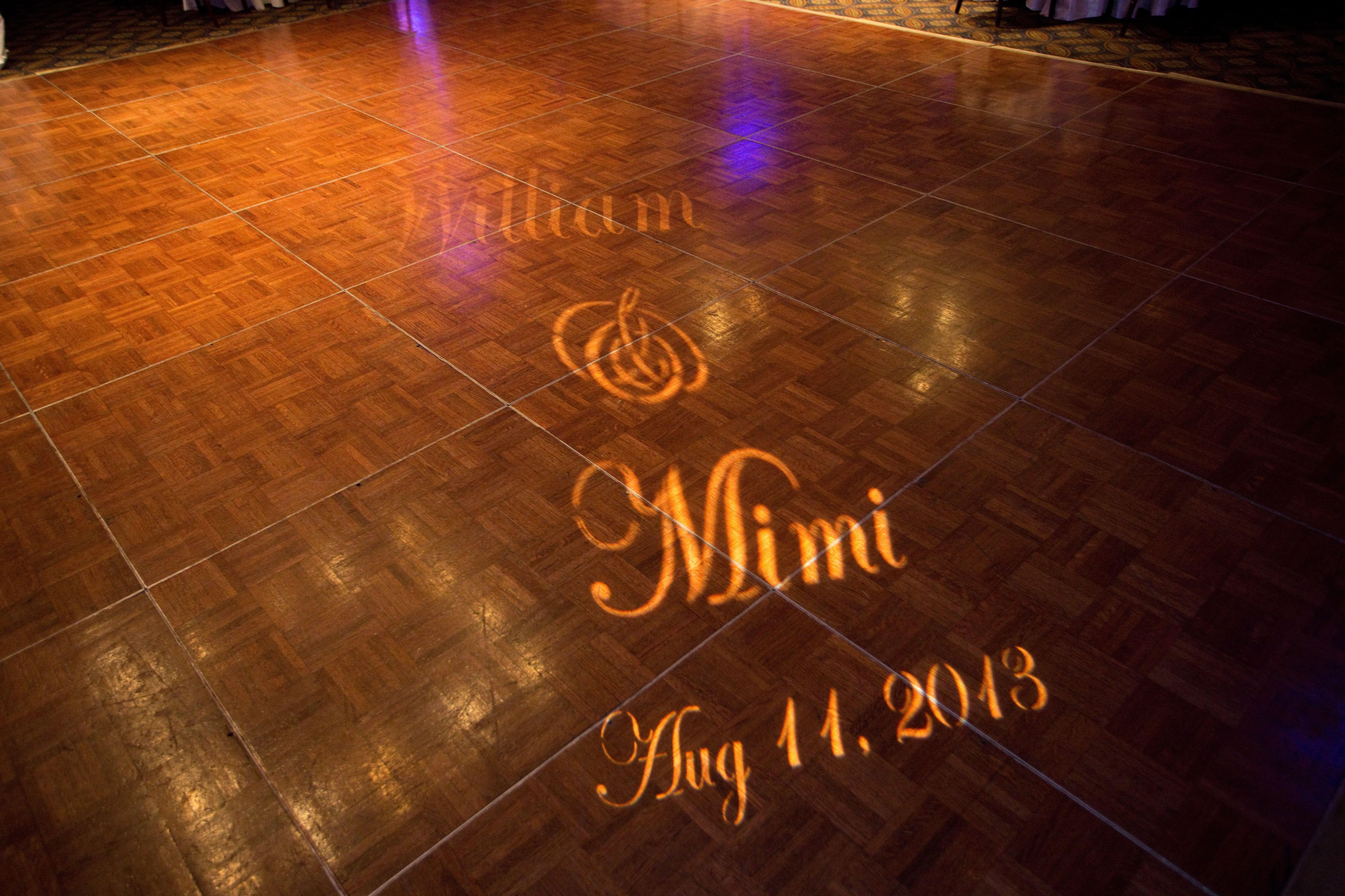 Hologram of our names and wedding date on the dance floor