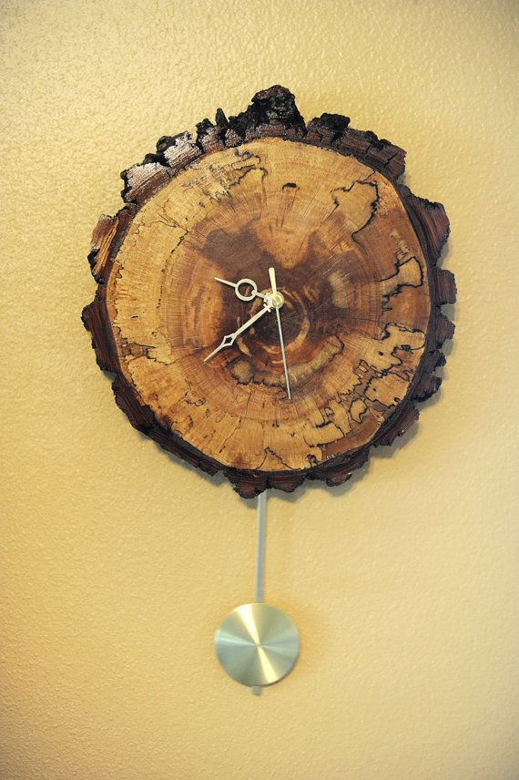 I think I'd like this much better without the pendulum, but still ... cool.    Rustic Wood Tree Slice Grandfather Clock / by cogdellphotography, $105.00
