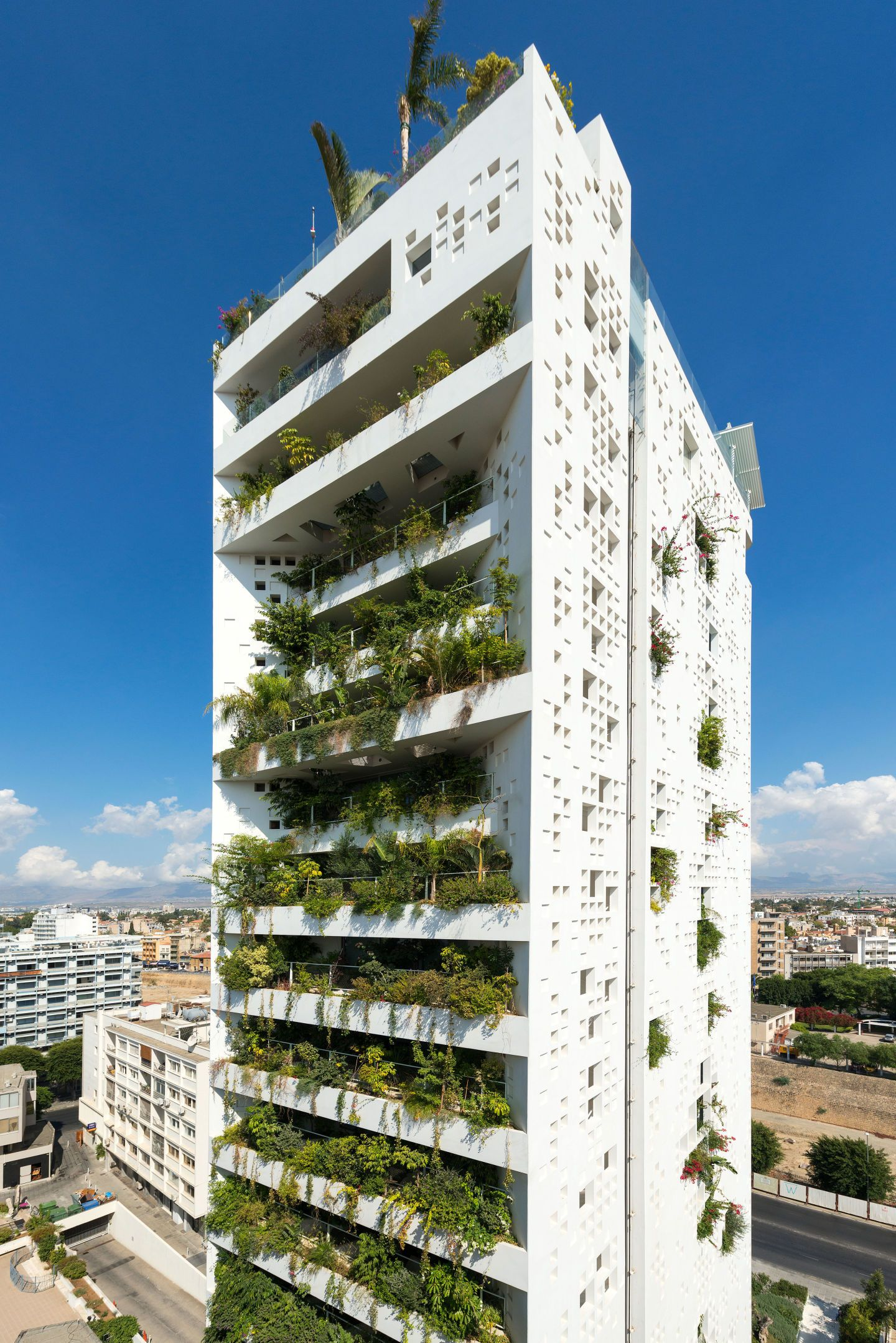 """To suit Cyprus Mediterranean climate Ateliers Jean Nouvel designed the building around what it describes as a """"natural brise soleil"""" – a facade where"""