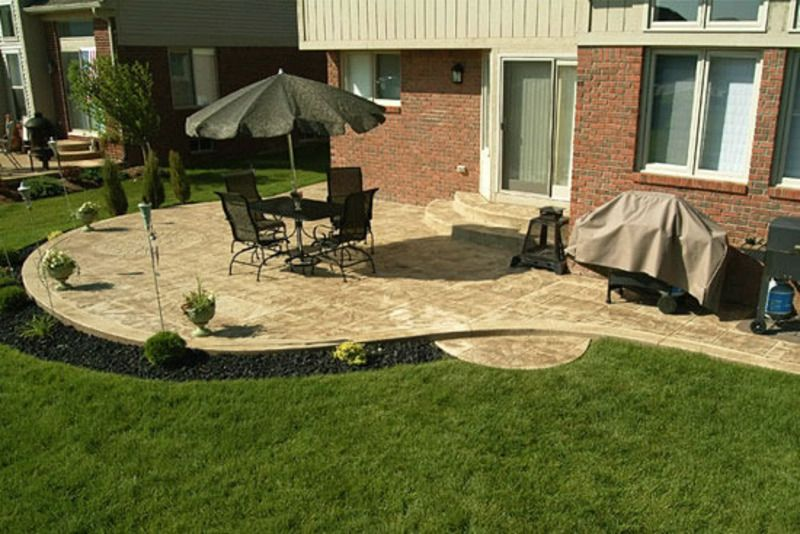 some backyard patio design ideas are a circular stone patio with wooden furniture backyard patio - Patio Designs Ideas