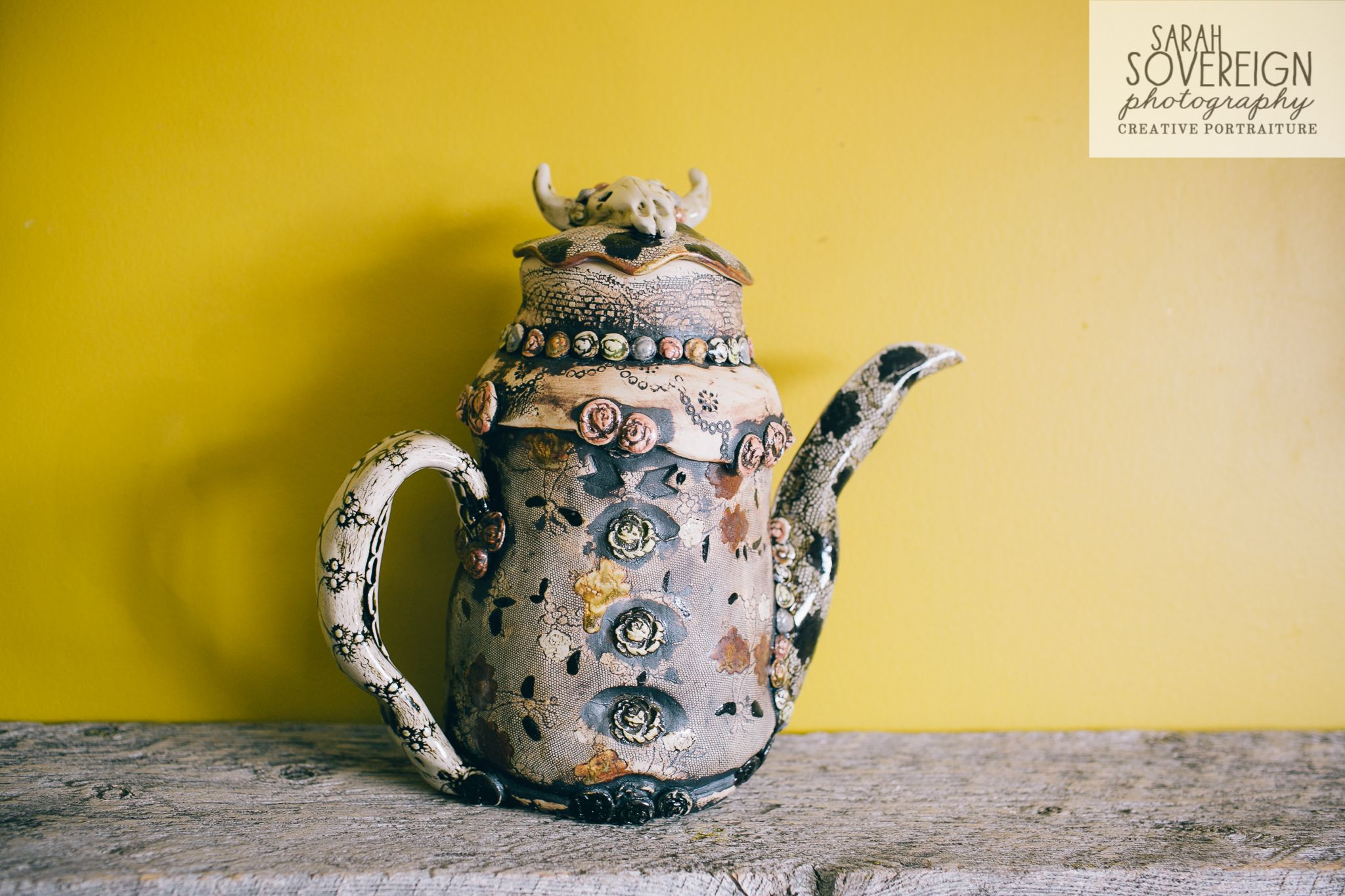 cowskull teapot, handbuilt porcelain clay with lace impressions, made at kilnhouse studio  www.facebook.com/kilnhousestudio