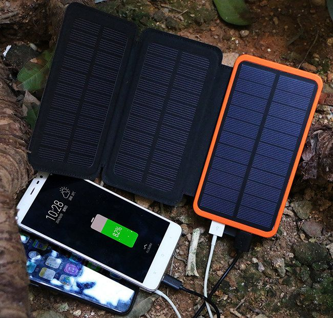A Portable Charger Bank With A Foldable Solar Panel To Give Your Phone A Jolt Anywhere Without Having To Lug Around A Usb Cord And Clunky Charger Box Solar Power Solar