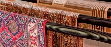 After Your Rug Is Cleaned Proper Drying Is Essential To Avoid Unnatural Shrinkage We Hang Rugs To Dry On A Special Rack In A Cont Rug Cleaning Area Rugs Rugs