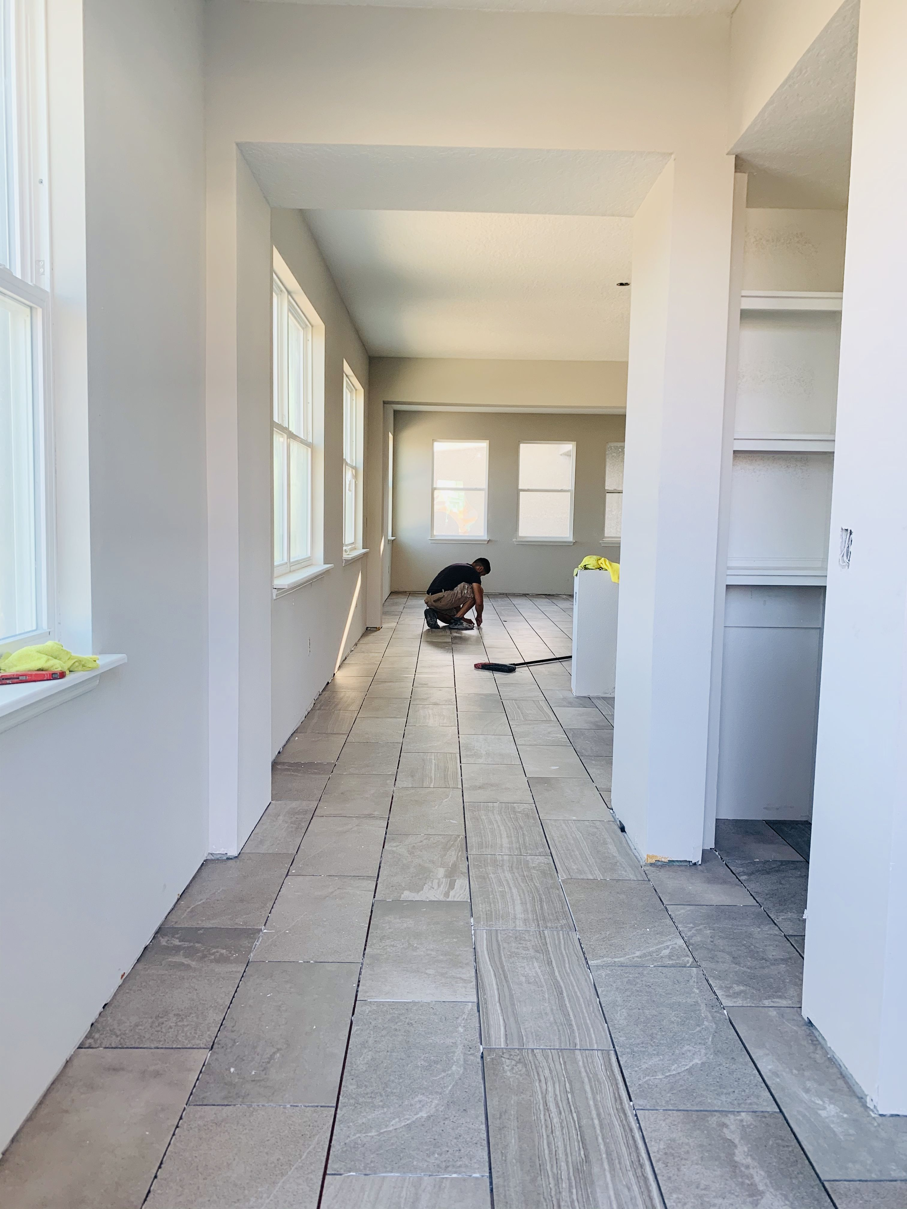 Looking to maximize space? vertical textured wood tile is perfect!  Allows the entry to instantly open up. #newhomeconstruction  #newhomeideas
