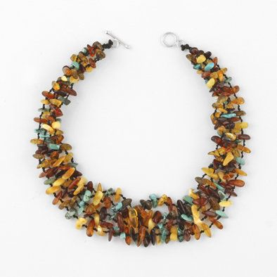 Amber and turquoise necklace. Double Knotted inbetween every stone!