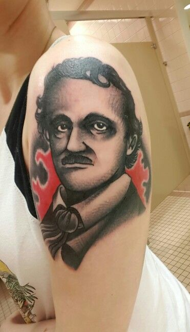 I got this sick Edgar Allan Poe tattoo yesterday! It was done by Johnny Awesome at Smokin guns down in Fayetteville, NC