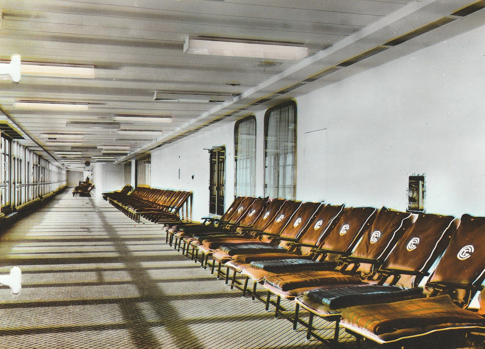 The First Class Pont Promenade, with serried enfilade of deck chairs, of the France of the Compagnie Générale Transatlantique, more commonly known as The French Line. 1962. Image courtesy the private collection of John Cunard-Shutter.