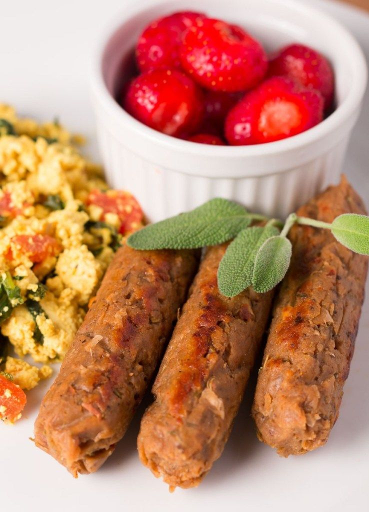 Breakfast sausage links with tofu scramble and bowl of