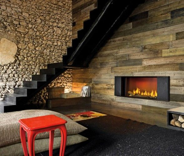 wide wood plank wall with modern fireplace and stone wall, dark ...
