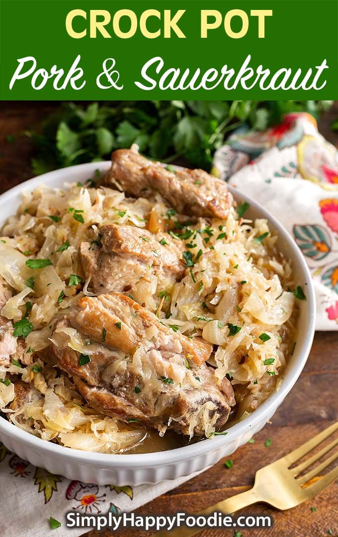 Crock Pot Pork and Sauerkraut is a tasty German recipe. This slow cooker pork and sauerkraut recipe has fall apart pork ribs and tangy sauerkraut. Good family meal! simplyhappyfoodie.com #slowcookerporksauerkraut #crockpotporksauerkraut #crockpotmeals