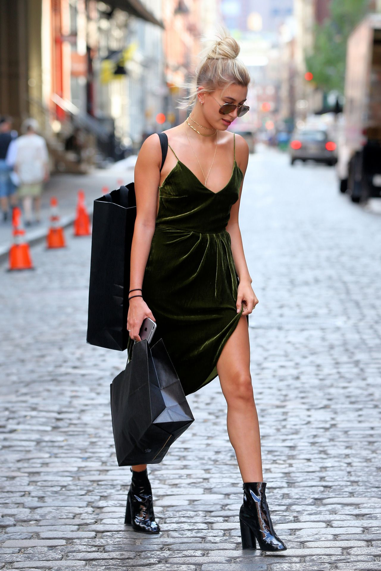 d44f6cb62de61 Hailey balwin in a strappy velvet dress and black booties is so perfect for  Summer
