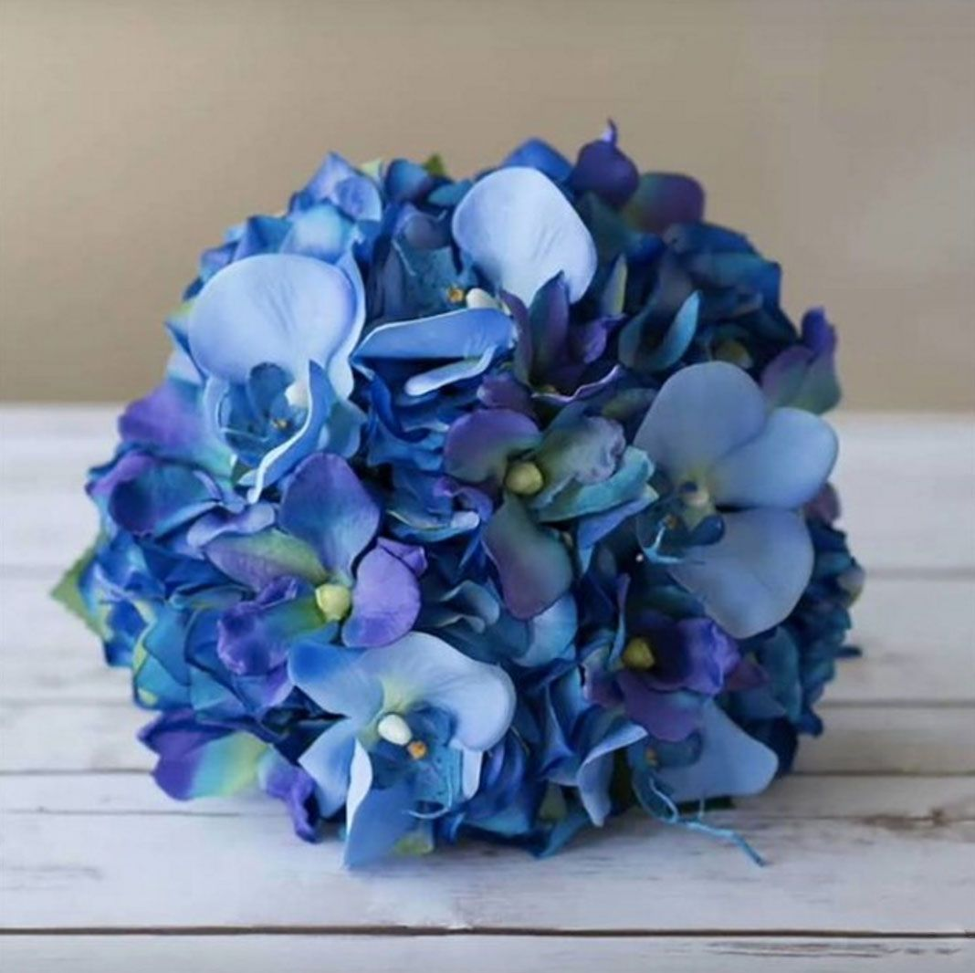 Weve got the blues blue wedding flowers that is beautiful blue wedding flowers that is beautiful orchid and hydrangea wedding bouquet created by the amazing wedideas with faux flowers from afloral izmirmasajfo
